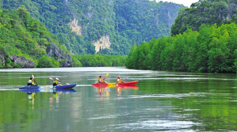 Cayaking in front of Pu Yu Cave at Ban Hua Tang Fisherman Village, Satun Published in Visit Ba Kan Yai-Hua Tang, in the middle of Andaman Monsoon, Osotho Magazine, Issued : August, 2013 *** Local Caption *** พายเรือคายัคที่หน้าถ้ำลอดปูยู บ้านหัวทาง จังหวัดสตูล ในสารคดี เที่ยวบากันใหญ่ขหัวทาง กลางมรสุมอันดามัน อนุสาร อ.ส.ท. ประจำเดือนสิงหาคม 2556